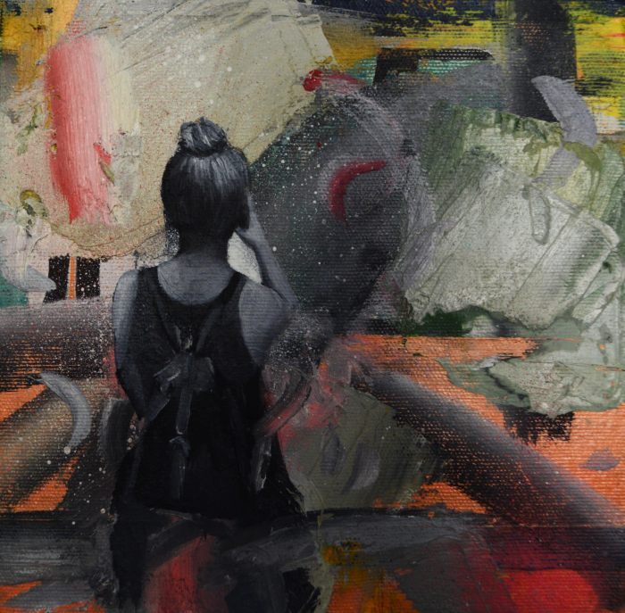 An abstract painting. The back of a person wearing a tank top and a bun in their hair is on the left.