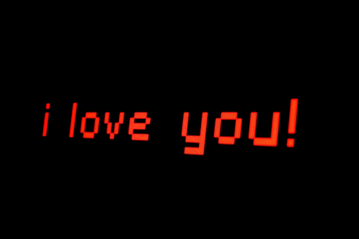 "Image Description: ""I love you"" written in red, digital font against a black background."