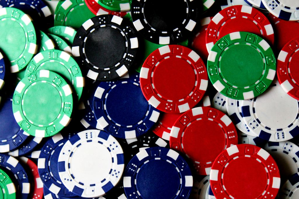 close up of red, green, blue, black and white poker chips