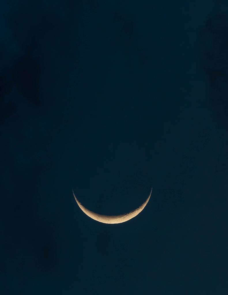 Photo of a waning moon in night sky