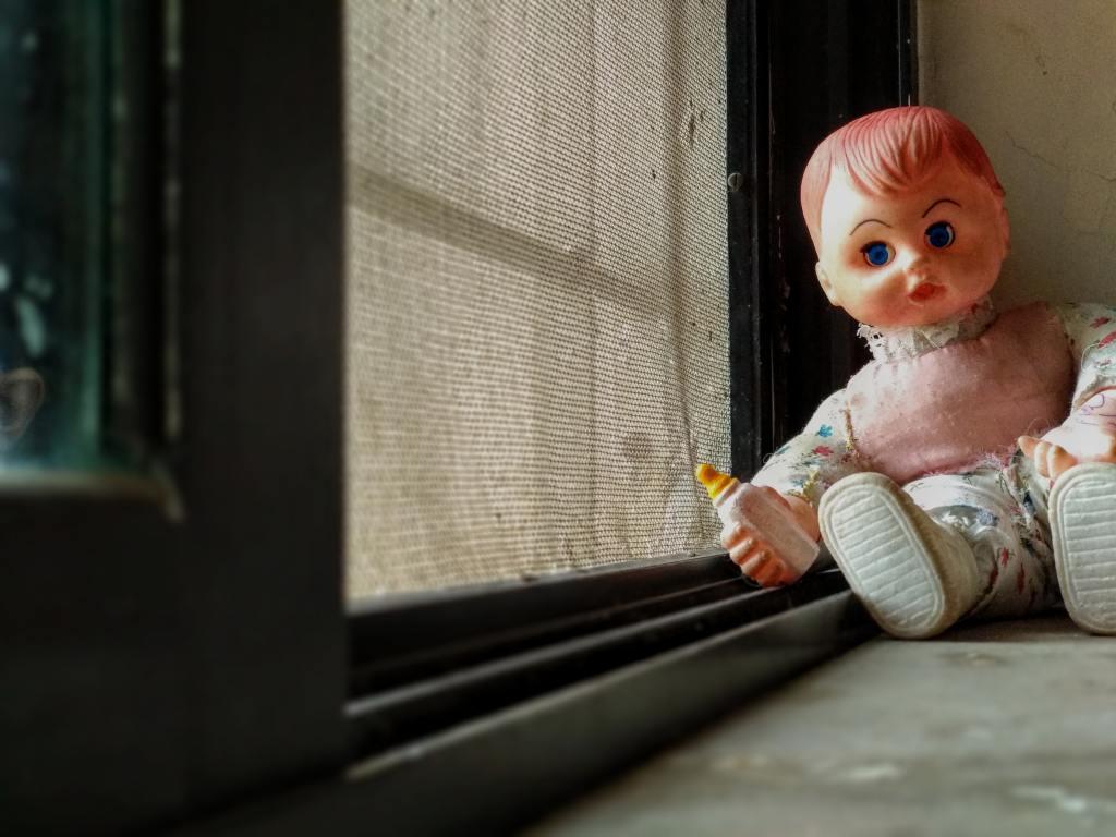 Descriptive image of a slightly creepy baby doll.