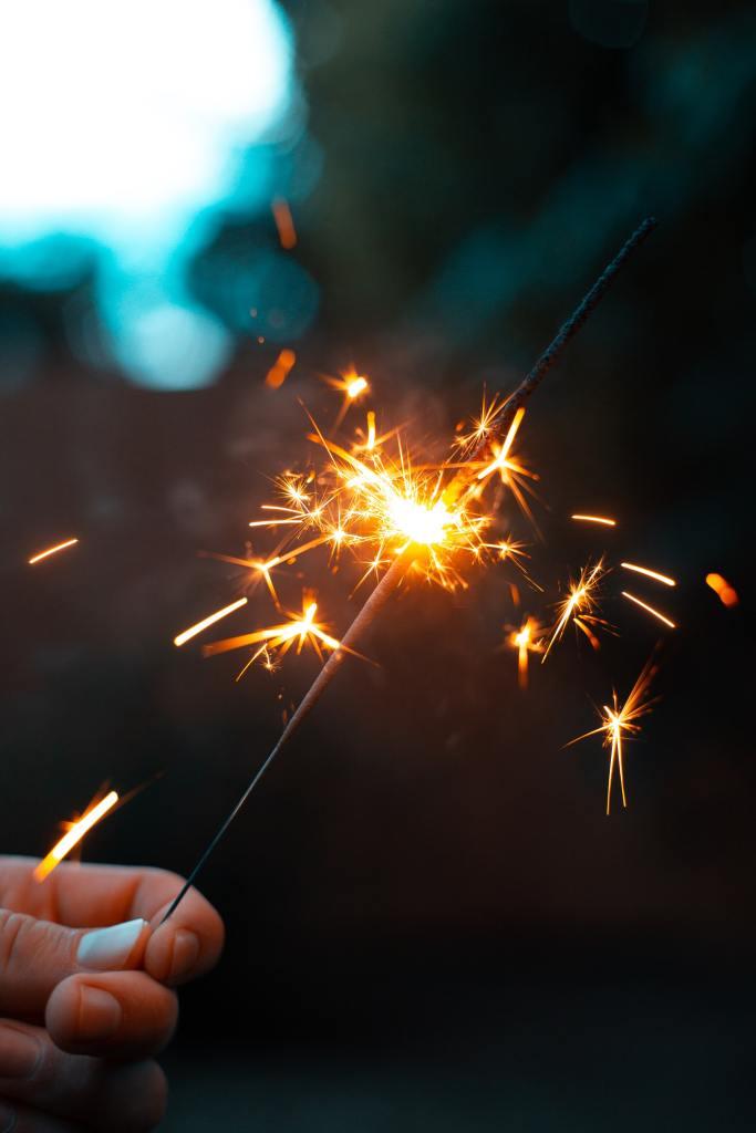 Descriptive image of sparkler burned halfway down.