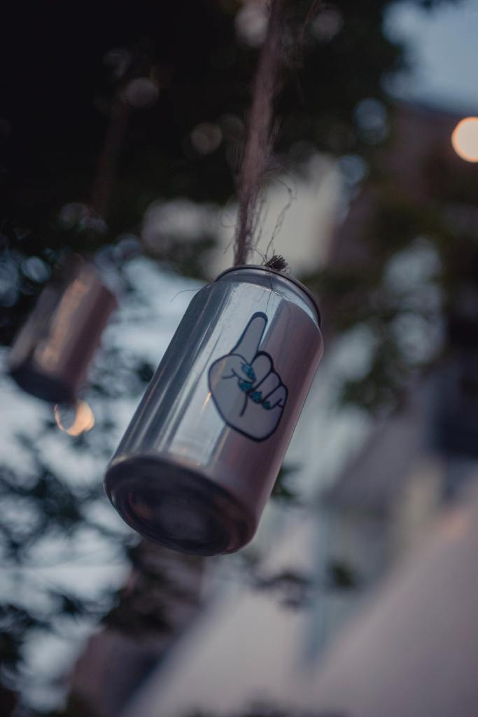 Descriptive image of cans hanging from string.