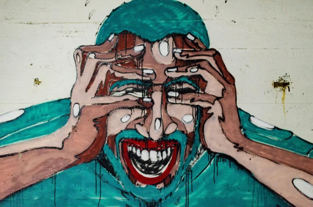 Graffiti cartoon of a man screaming.