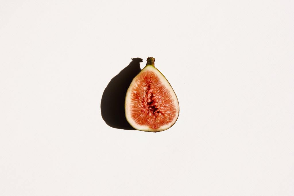 Fig and shadow against a white wall.